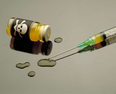 dangerous ideas: Poison and plastic syringe Stock Photo