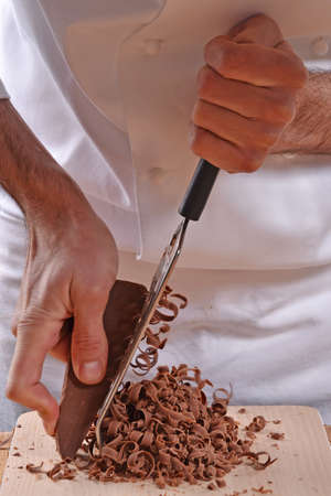 Pastry chef hands preparing brownies Stock Photo