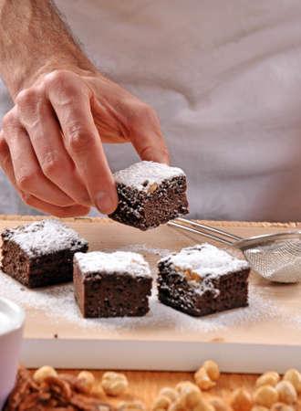 Pastry chef preparing brownies