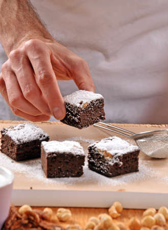 Pastry chef preparing brownies