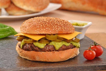 classic burger: Jalapenos rustic cheese burger and avocado sauce. Stock Photo