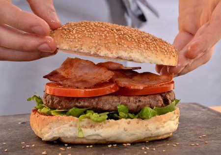 Cook hands preparing and making hamburger. Stock Photo
