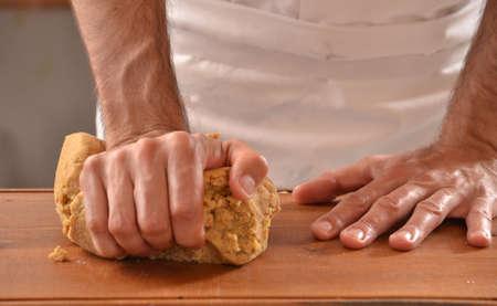 preparing dough: Cook preparing dough for cookies.Hands kneading dough.