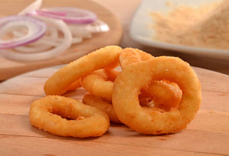 Onion rings on wood table and ingredients