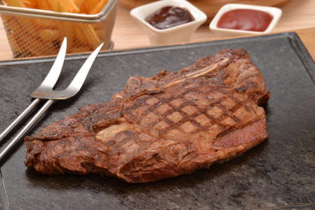 provocative food: Grilled beef steak on stone and fried potatoes
