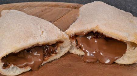 indulgence: Chocolate cream filling parzerotto bread. Stock Photo