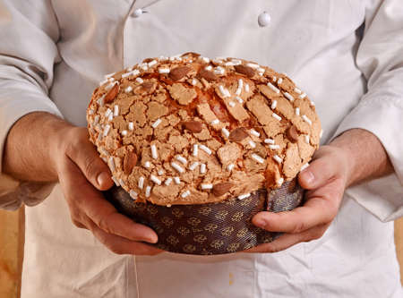 provocative food: Baker holding panettone bread.