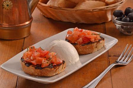 mozzarella cheese: Bruschetta and mozzarella cheese dish.bruschetta with tomato and mozzarella cheese ball. Stock Photo