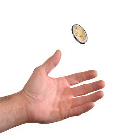 cheapness: Hand holding coin on white background