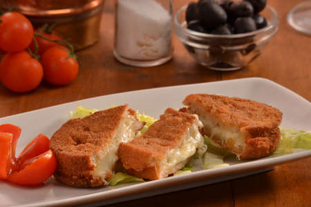 breaded: Breaded mozzarella cheese snack dish.