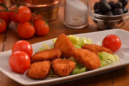 nuggets: Breaded chicken nuggets dish. Stock Photo