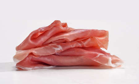 provocative food: Sliced ham on white background.Fresh prosciutto.Pork ham sliced on white background.