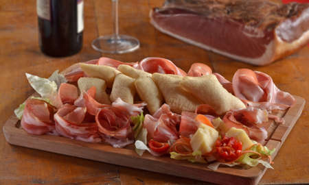 provocative food: Sliced prosciutto mix and salami with fried cheese dish.