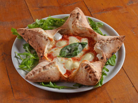 particular: Original Italian pizza in particular form dish. Stock Photo