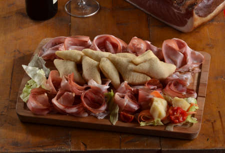 provocative food: Sliced prosciutto and salami