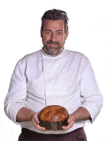 provocative food: Baker portrait holding panetone bread on white background.