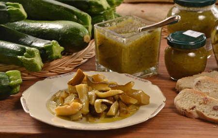 provocative food: Zucchini dish and ingredients. Prepared zucchini dish salad on sauce, jam and ingredient. Stock Photo