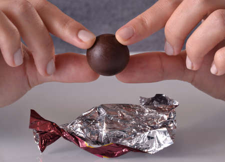 half ball: Opening chocolate candy ball from bag.