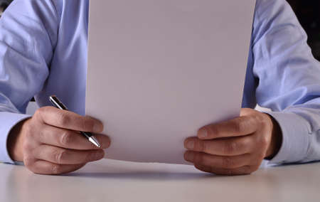 Businessman holding and reading document
