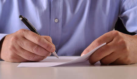 msn: Man hands detail writing and signing a document Stock Photo