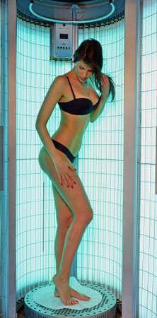 solarium: Solarium beautiful sensual woman in bikini.