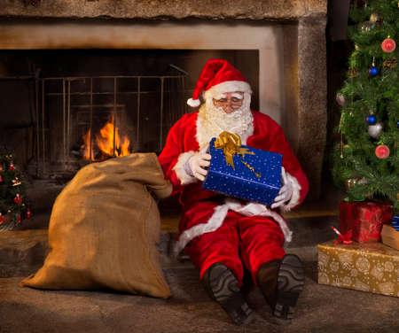 wildcard: Santa Claus opening gift Stock Photo