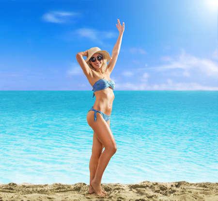 Summer blonde woman enjoy the beach.