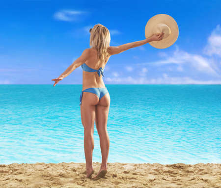 Summer blonde woman enjoying sunset on the beach.