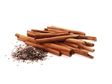 Cinnamon sticks and chocolate on white background