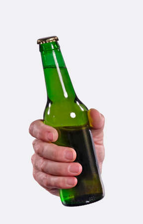 Bad hand holding a beer bottle on white background.