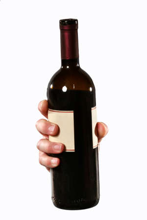 Hand hold a red wine bottle Stock Photo