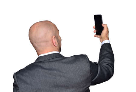 Man taking selfie picture with cell phone. Stock Photo