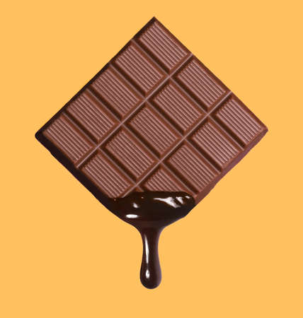 Dark chocolate bar and melted brewing drop.