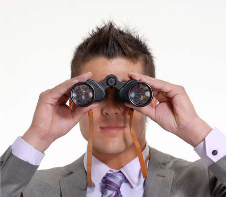 man looks a coronavirus arriving from long distance using a binoculars Banque d'images