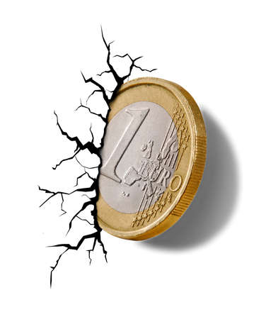 Europe Union collapse economy on Euro coin embedded on wall and crack.