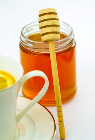 wooden honey dipper  photo