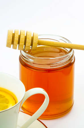 Fresh honey in jar and tea  photo