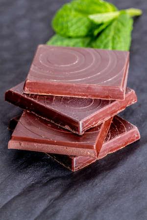 dark: dark chocolate pieces stacked