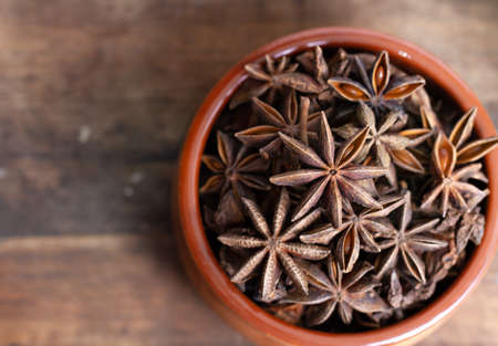 star anise in a bowl on wooden background Archivio Fotografico