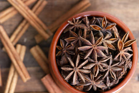star anise in a ceramic bowl with cinnamon sticks