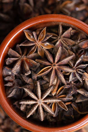 star anise spice in a ceramic bowl
