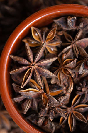 star anise in a ceramic bowl