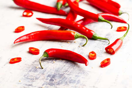 many chilli peppers on cooking table Stock Photo