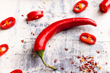 chilli pepper with cut chillies and chilli flakes Stock Photo