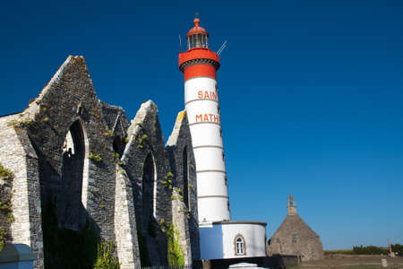 The lighthouse and the ruins of the abbey in Pointe Saint Mathieu Finistère in Brittany - France