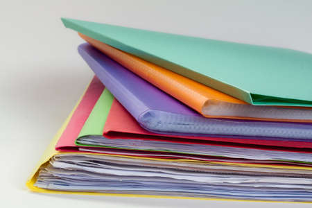 Stack of folders waiting on office photo