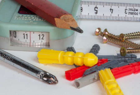 hollow walls: Tools and plugs for hollow walls Stock Photo