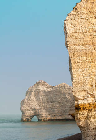 Chalk cliffs on the sides of Alabaster at Etretat in Normandy Seine Maritime - France Stock Photo - 25943957