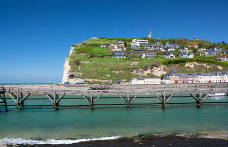 The wooden bridge and the cliffs of Fécamp Seine Maritime in Normandy - France photo