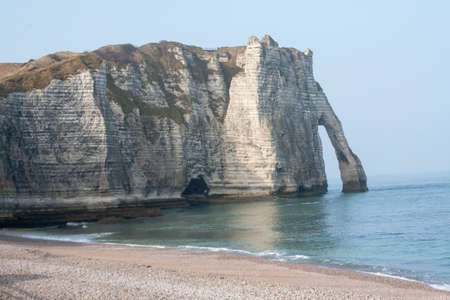 Cliffs and the needle has Etretat in Seine Maritime in Normandy - France photo